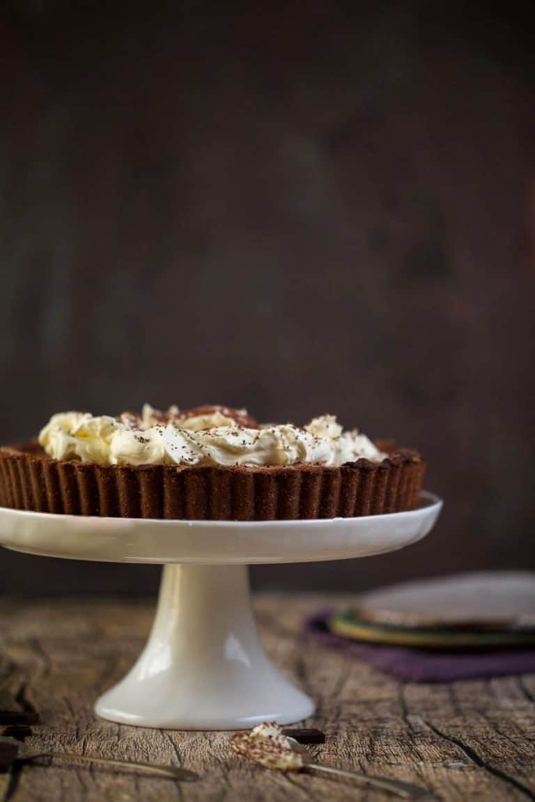 chocolate pie on a white cakes stand