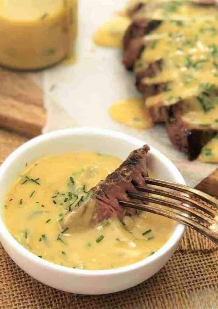 steak in mustard sauce in a white bowl