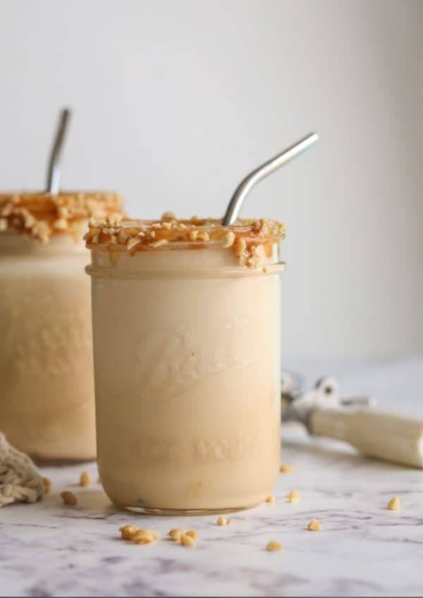 2 jars with brown smoothies in them