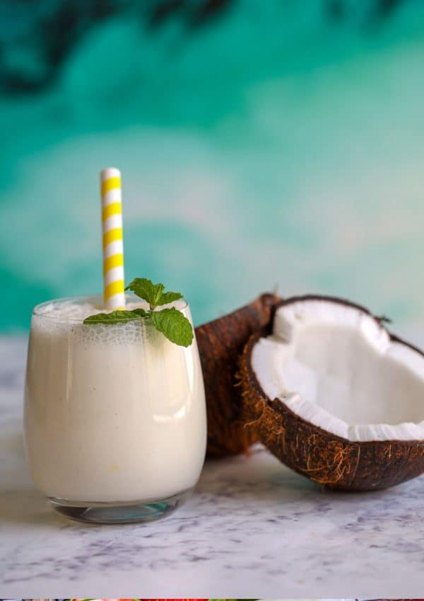 smoothie and coconut on white backdrop