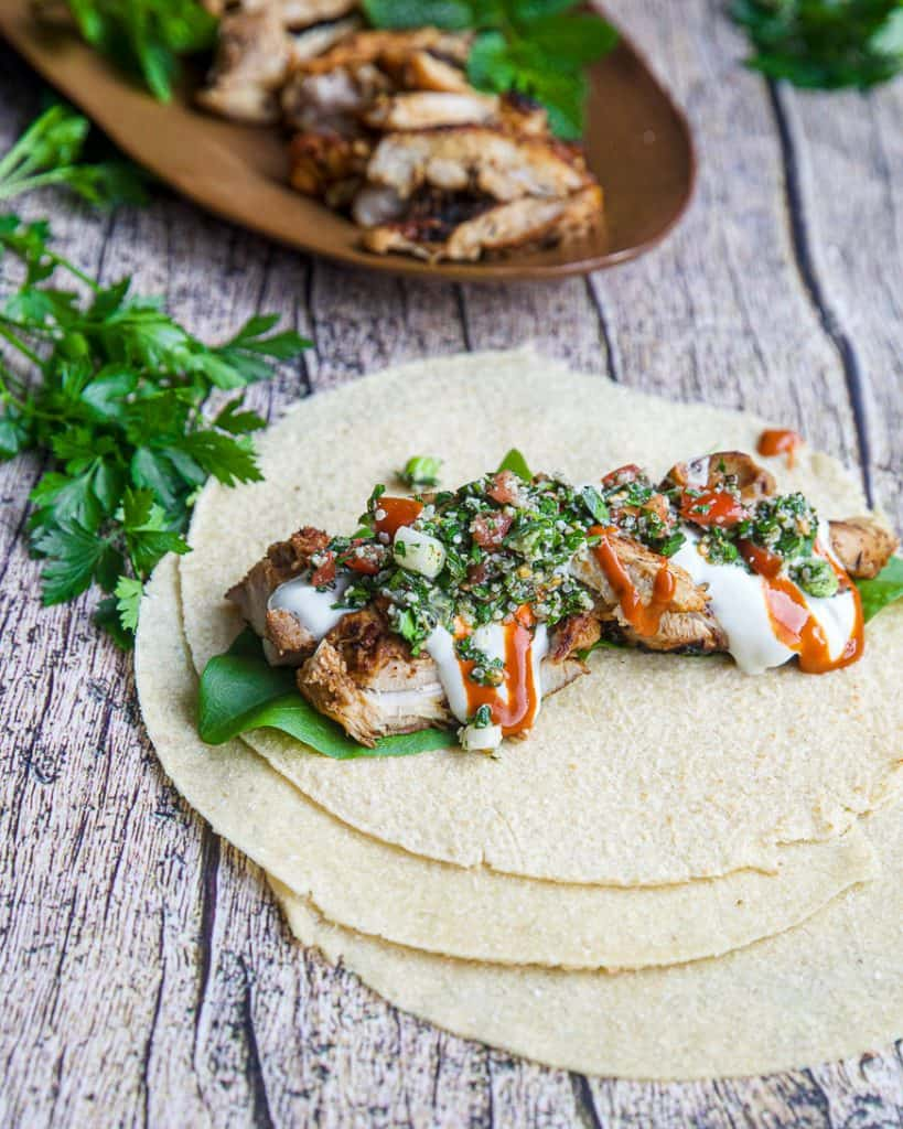 chicken shawarma on pita bread on a wood table