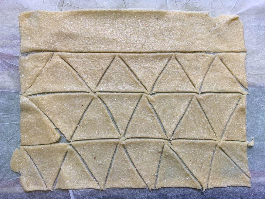 dough cut into corn chip triangles