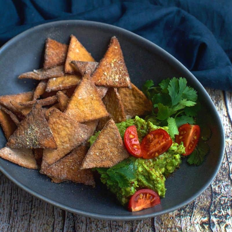 bowl of easy keto tortilla chips with avocado and tomato