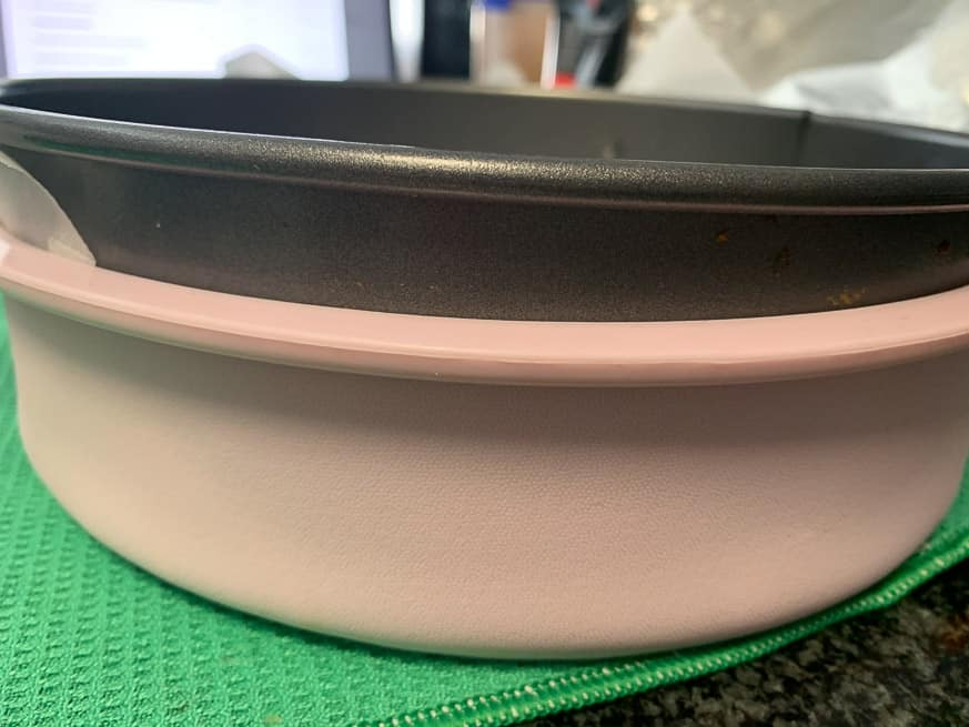 silicone cake tin on the outside of a cake tin