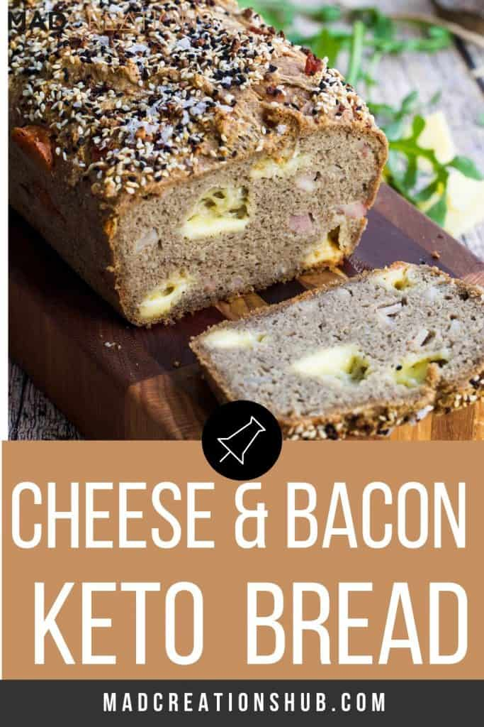 Keto cheese and bacon bread with the crust cut off on a bread board