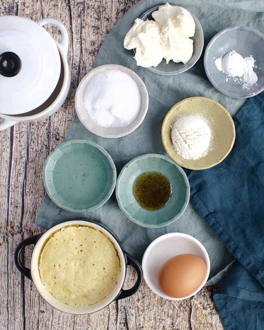 keto mug cake ingredients in small bowls