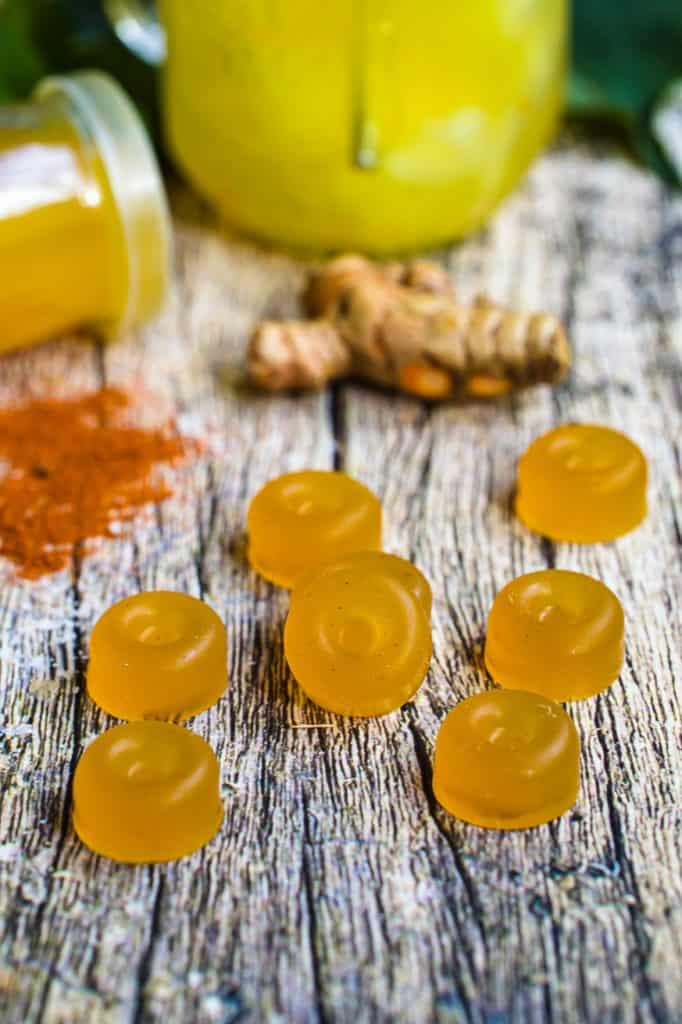 ginger elixir gummies on a wood table