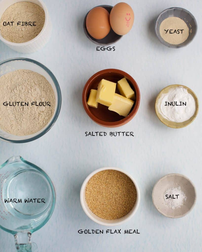 Low Carb bread ingredients in small bowls on a white background