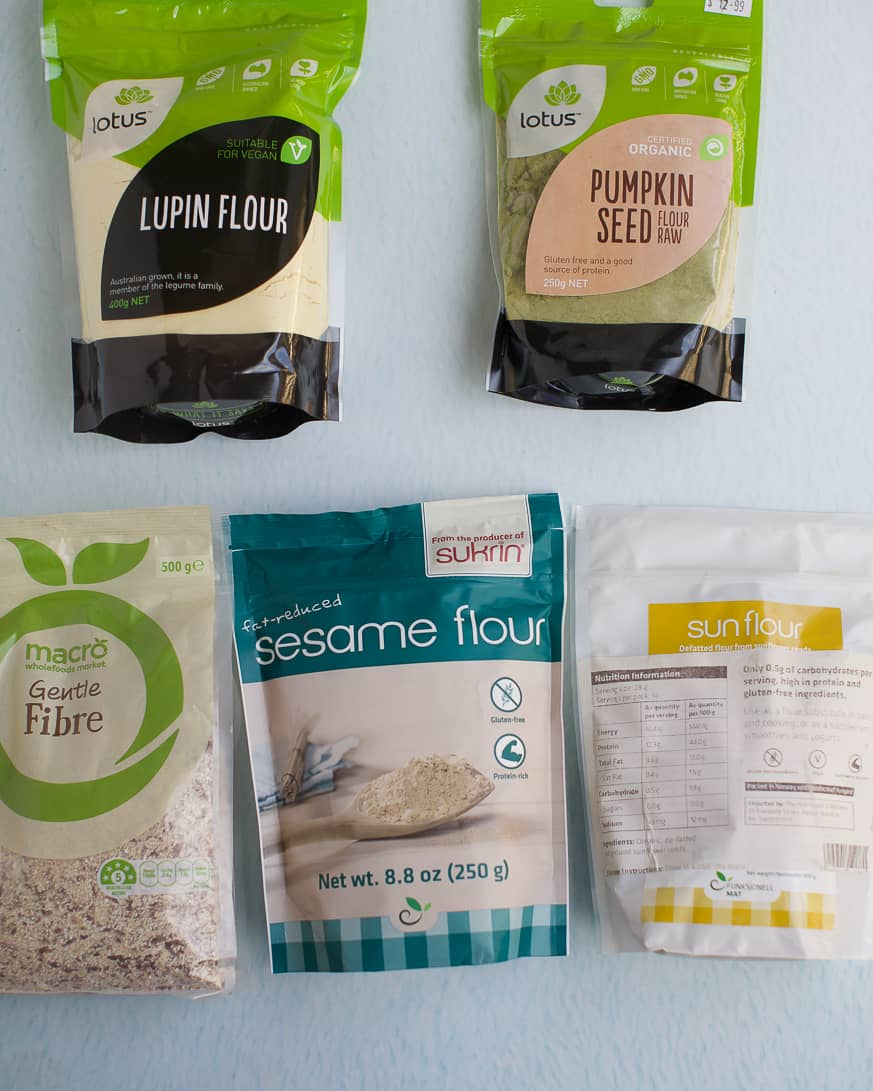 5 packet mixes of flours on a white background