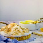 meringue pie on a blue cloth
