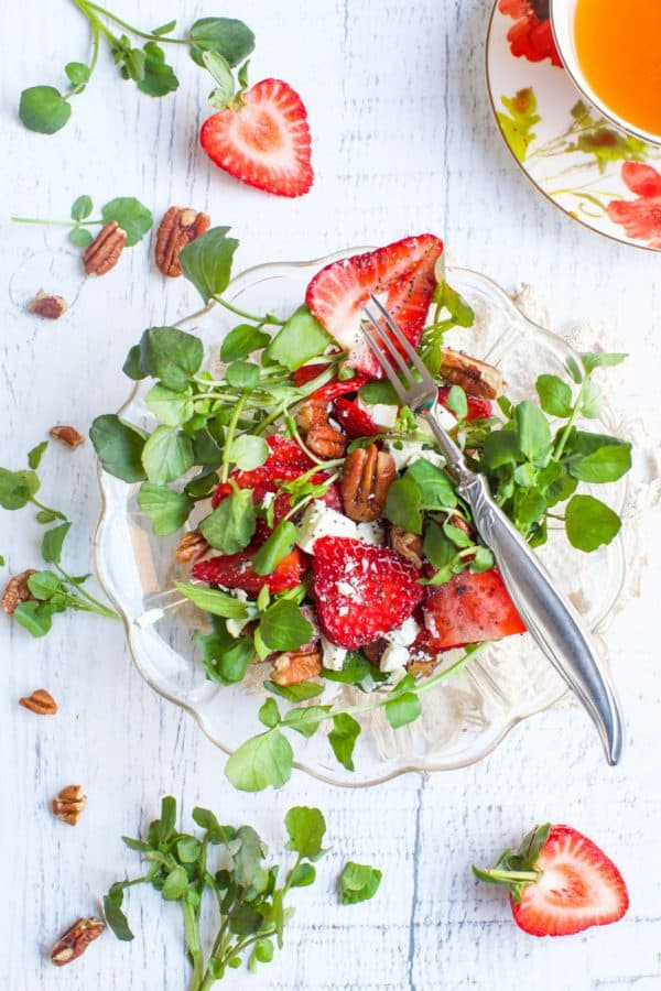 strawberry salad in a glass bowl