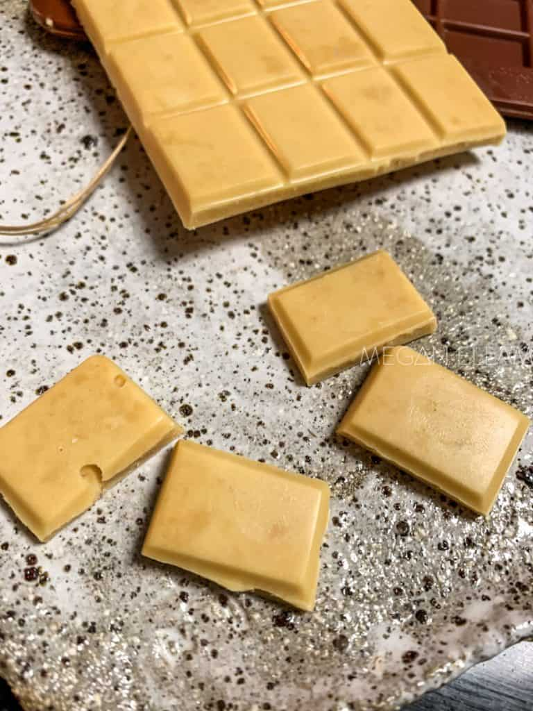 caramelized white chocolate pieces on a speckled plate