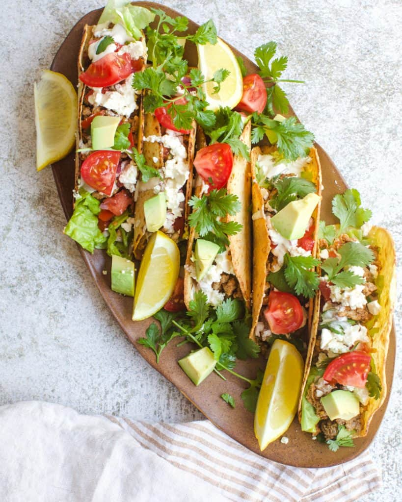 tacos on a brown plate
