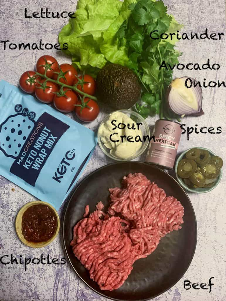 Keto Taco Recipe Ingredients on a grey backdrop