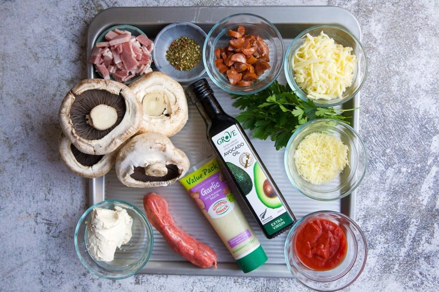 ingredients for a mushroom pizza on a baking tray