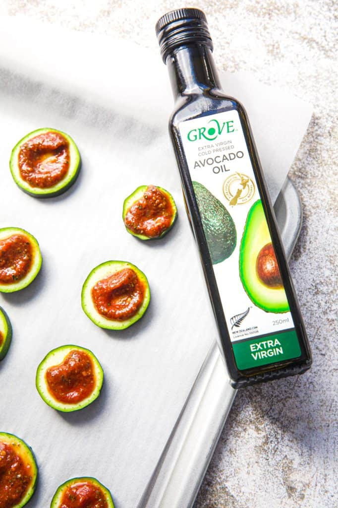 bottle of oil with sliced zucchini