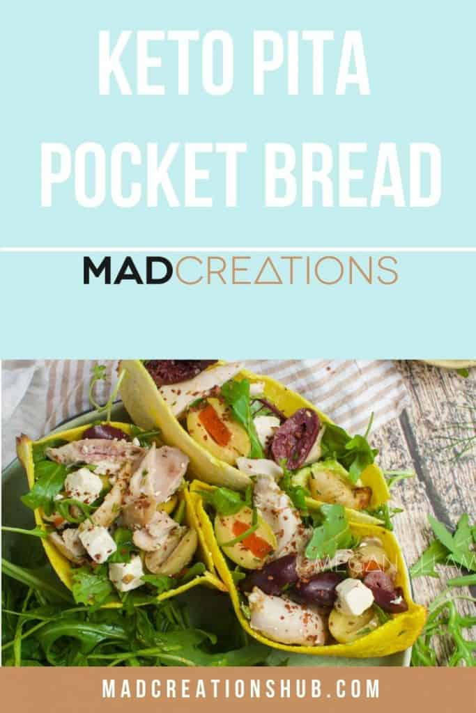 pocket breads filled with salad on a plate with leafy greens