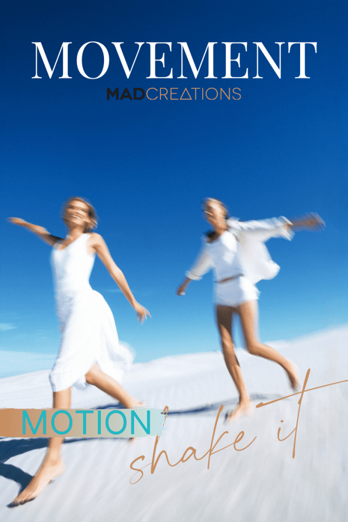 two girls in white running down the sand