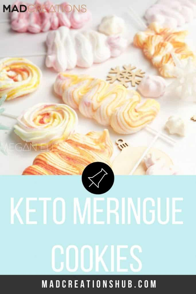 Keto Meringues scattered on a pink and white marble backdrop
