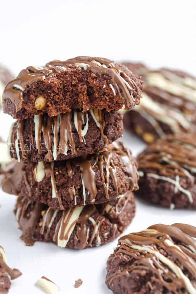 A stack of chocolate cookies piled high