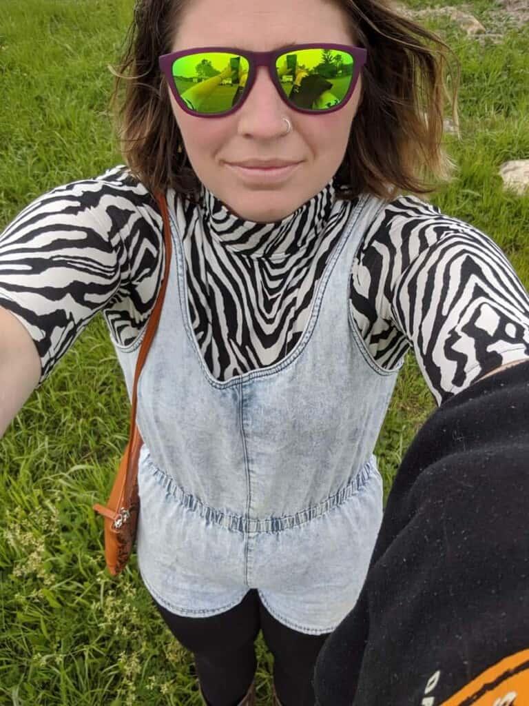 a woman in a denim jumpsuit