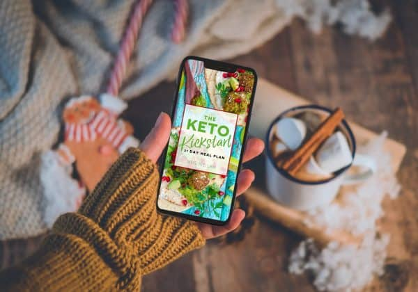 The Keto Kickstart ebook on a mobile in a girls hand