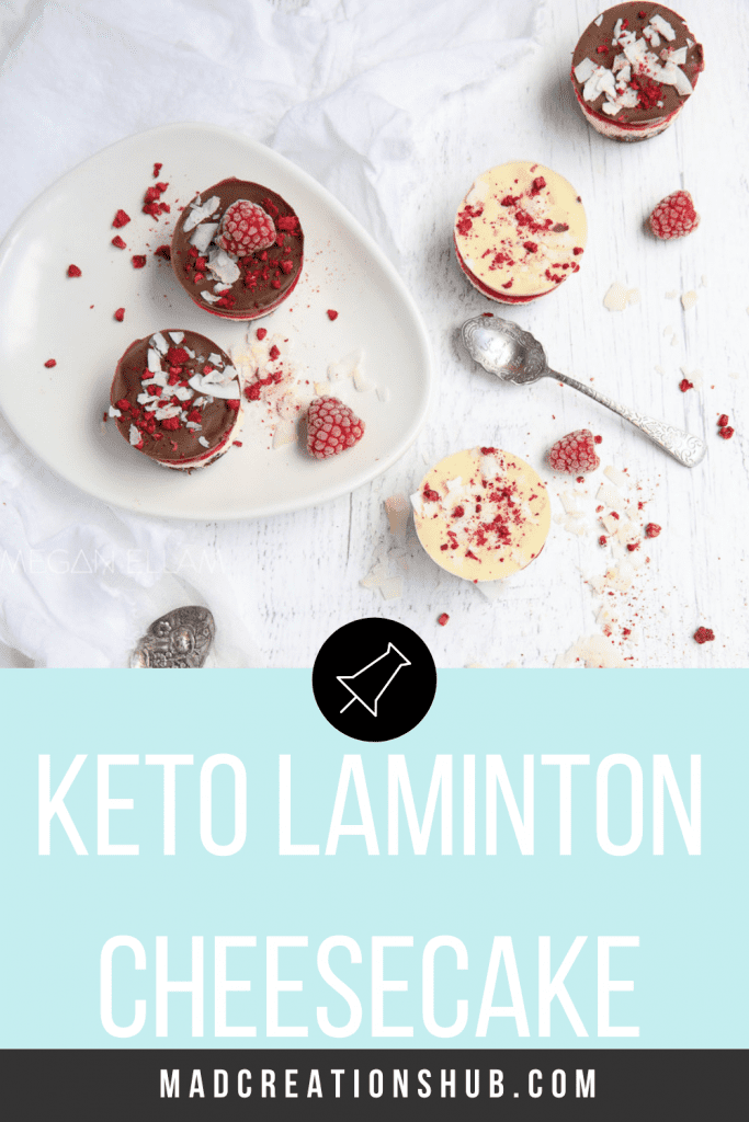 Keto Lamington Cheesecakes on white plates and a white table with crushed raspberries
