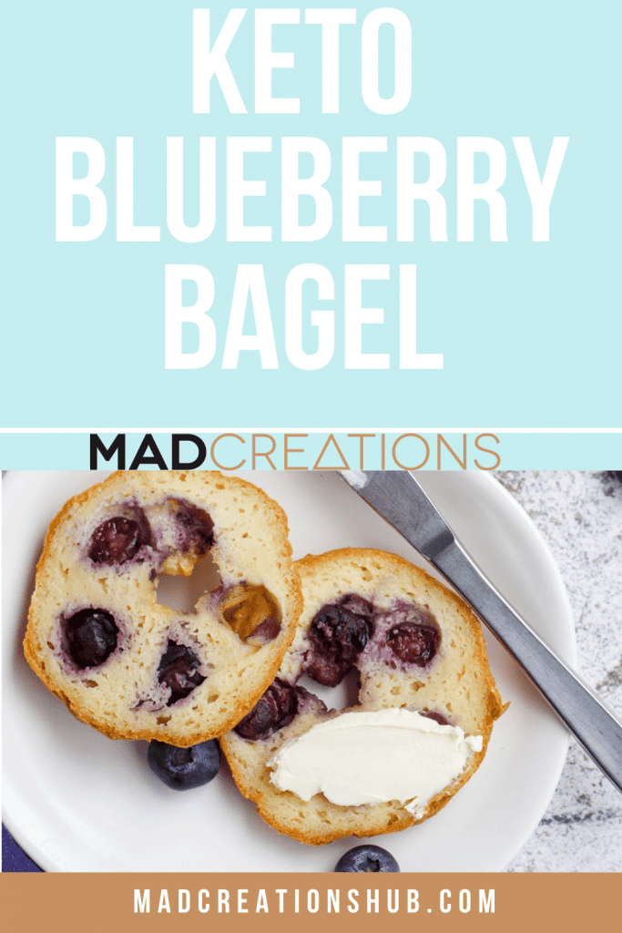 a blueberry bagel cut in half spread with cream cheese