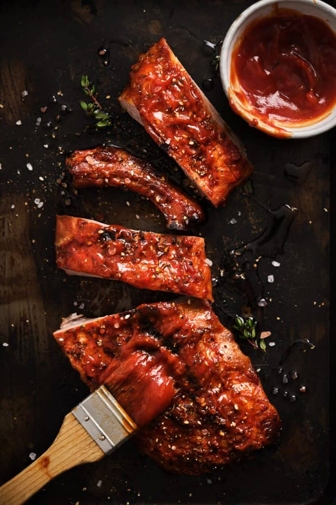 Pork ribs with barbecue sauce basted on them
