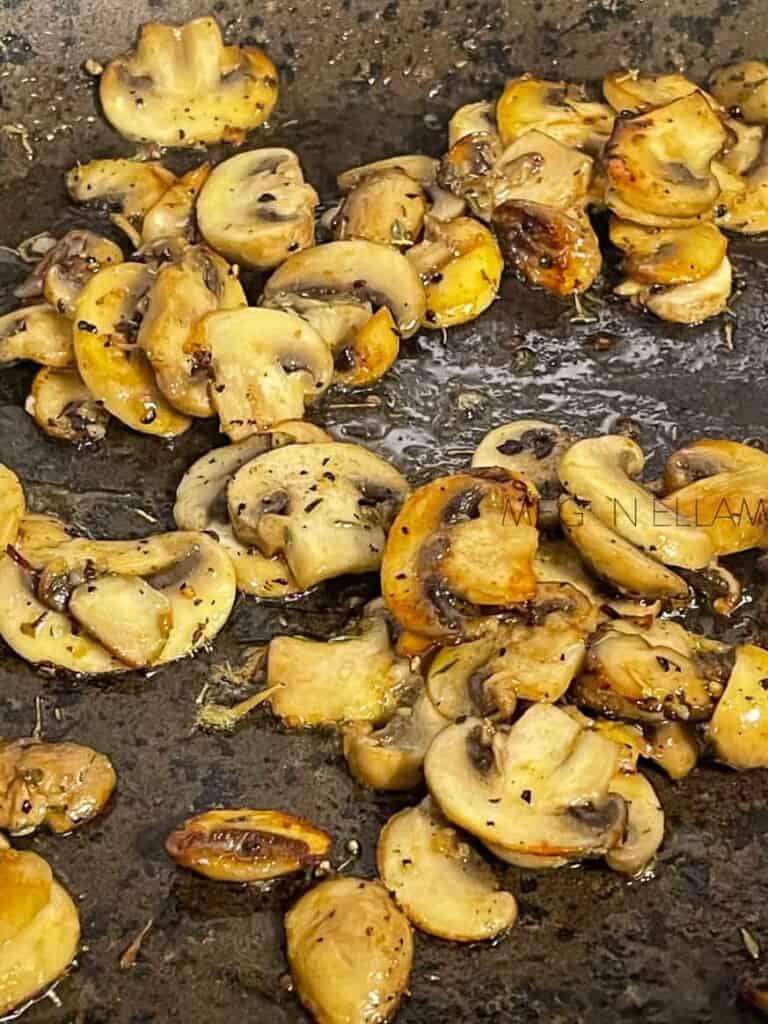 browned mushrooms in a frying pan
