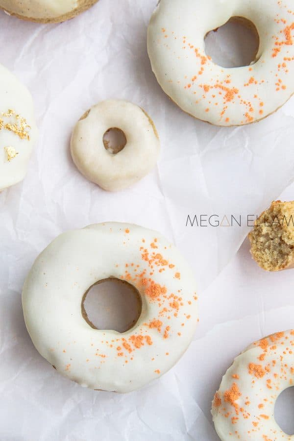 white iced donuts on white baking paper.