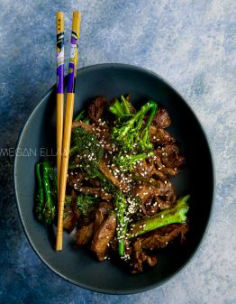 A bowl with beef and broccoli.
