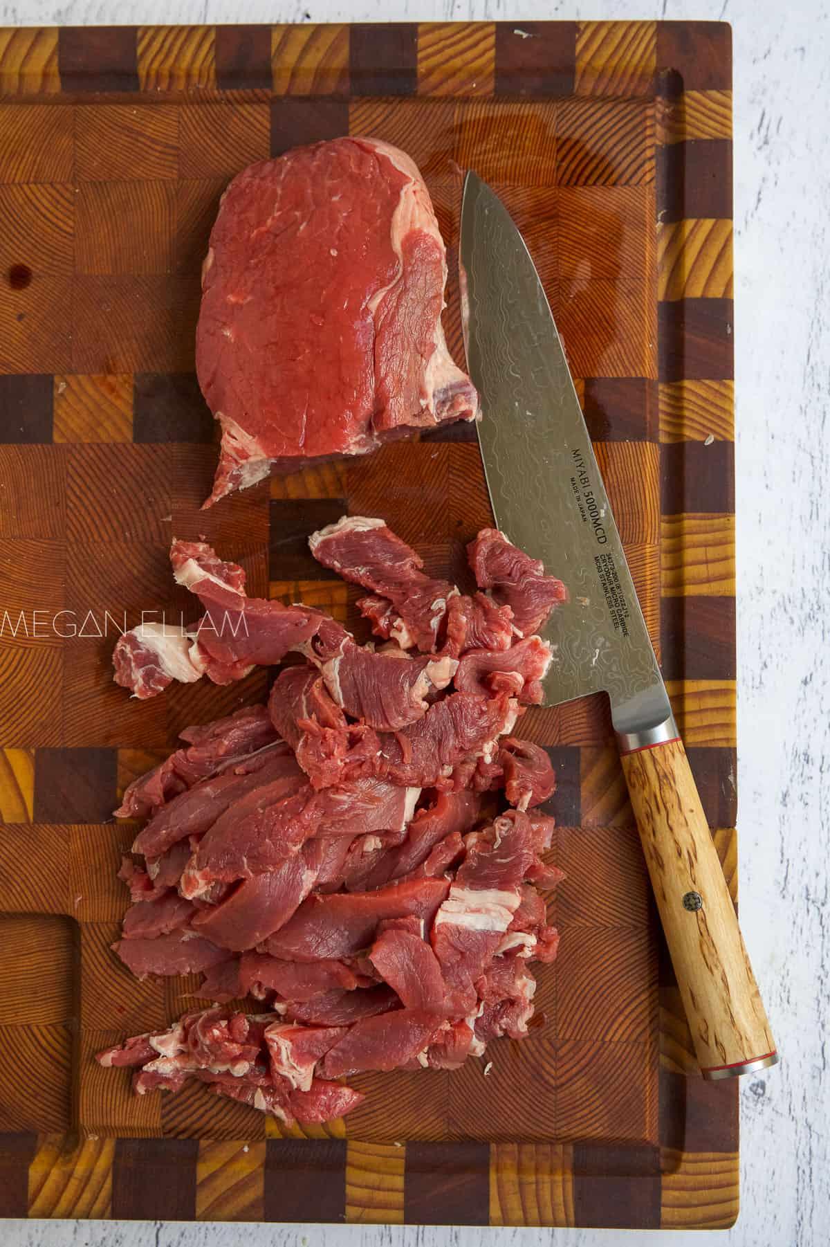Sliced Beef on a cutting board.