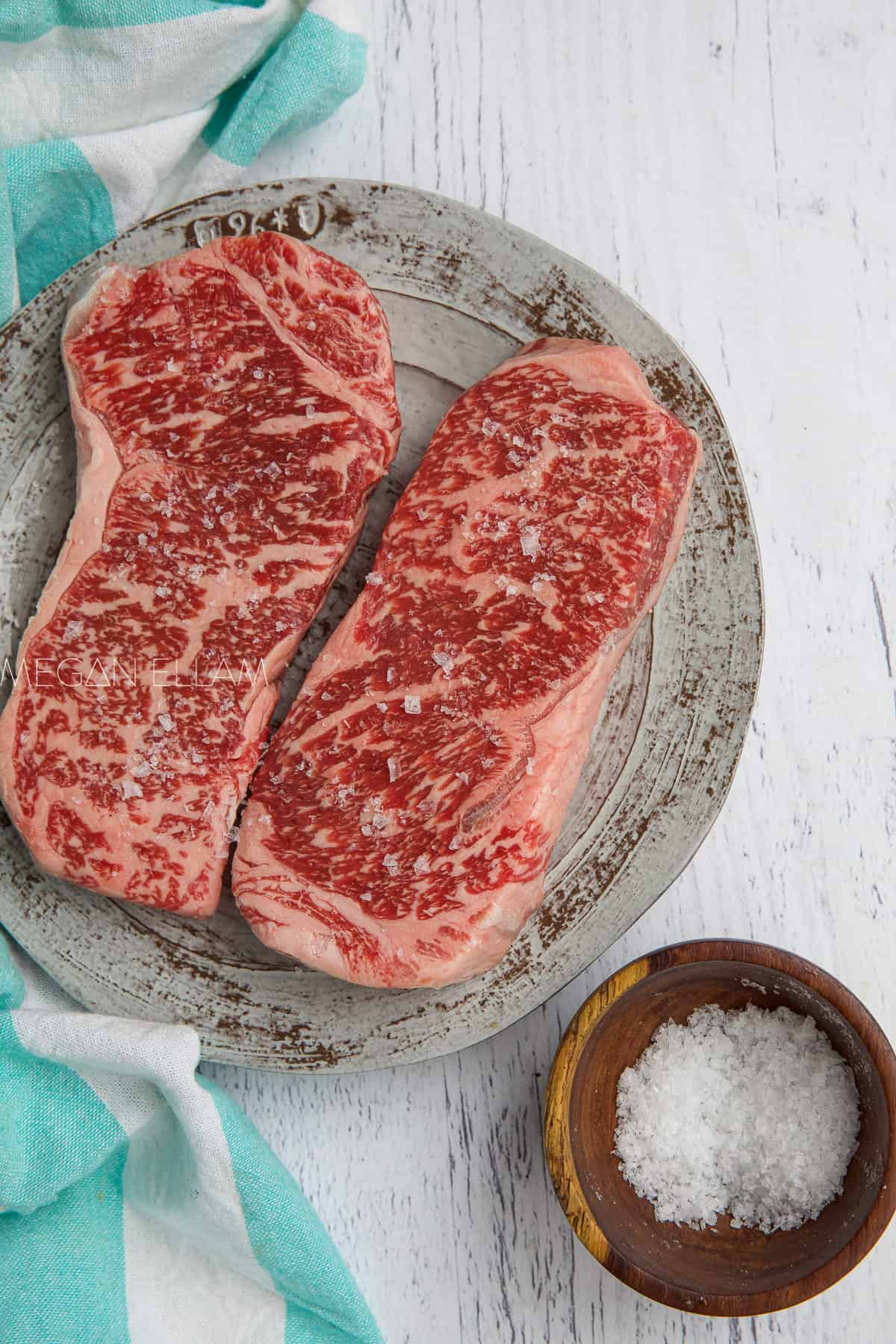 salted wagyu on a plate.