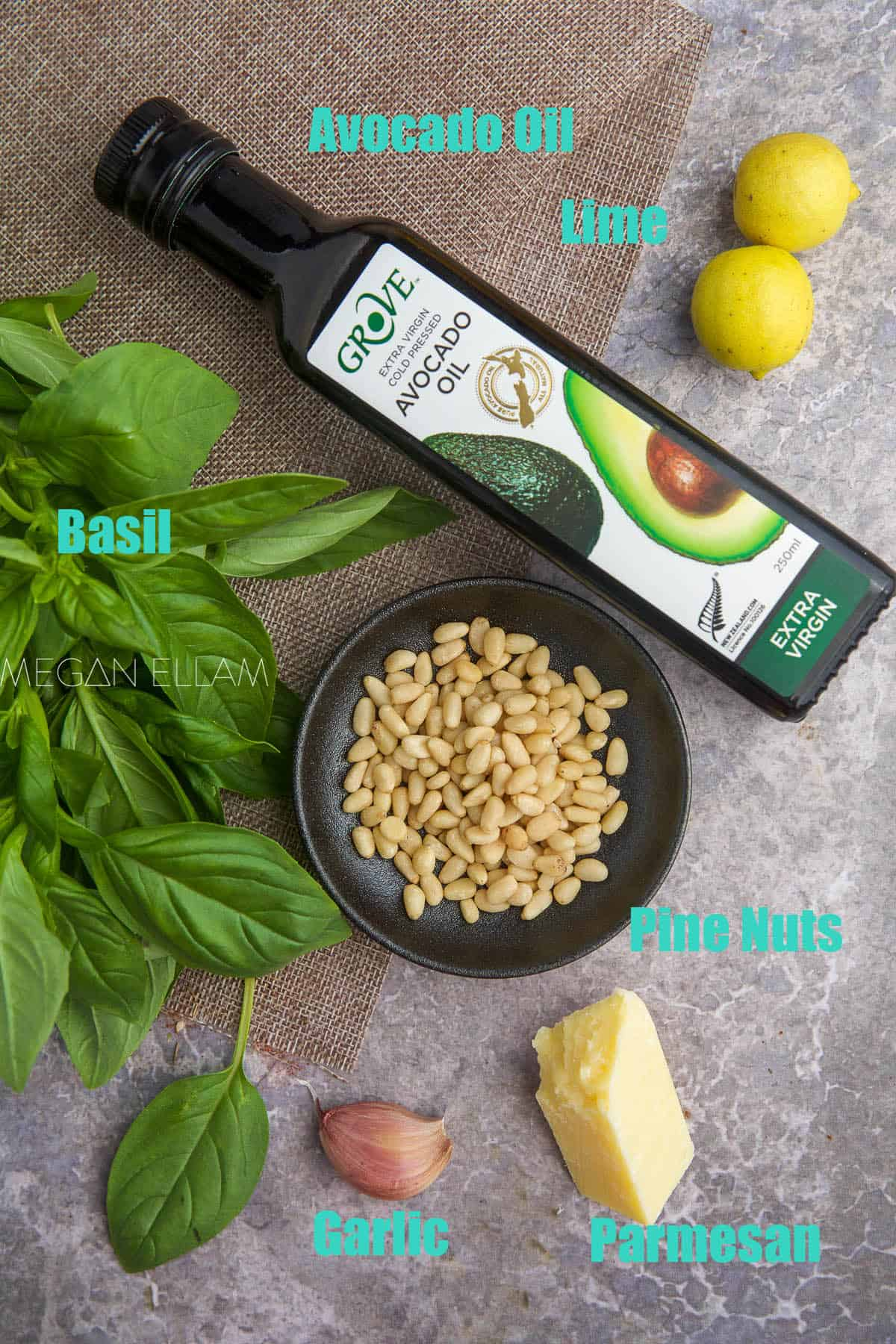 pesto ingredients on a wood backdrop.