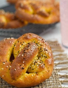 A soft keto pretzel in front of a cooling rack.