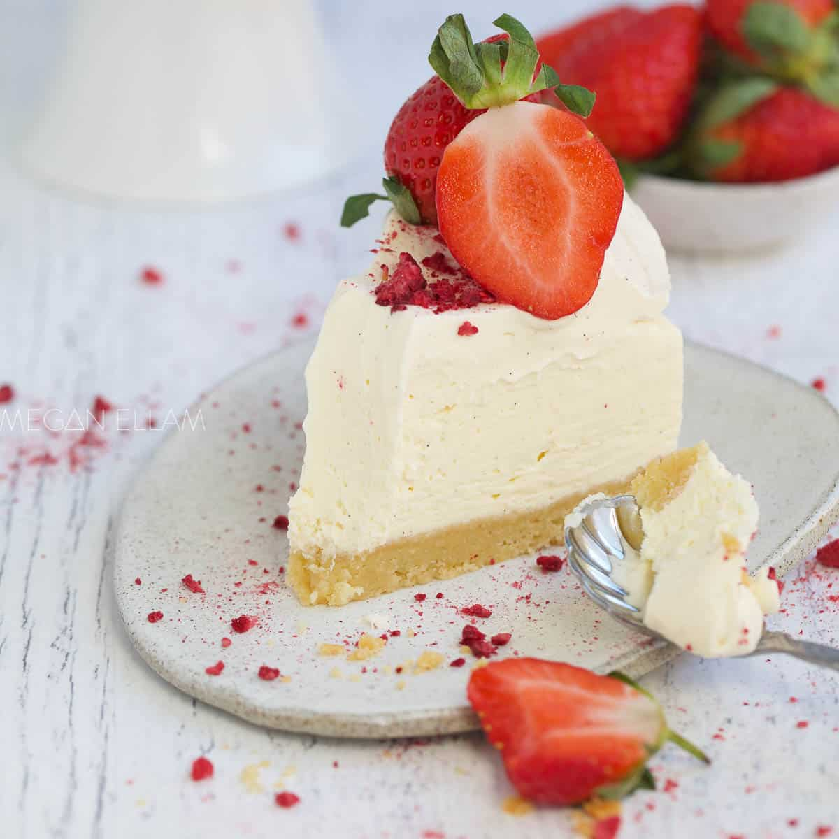 No Bake Keto Cheesecake on a white plate with strawberries.