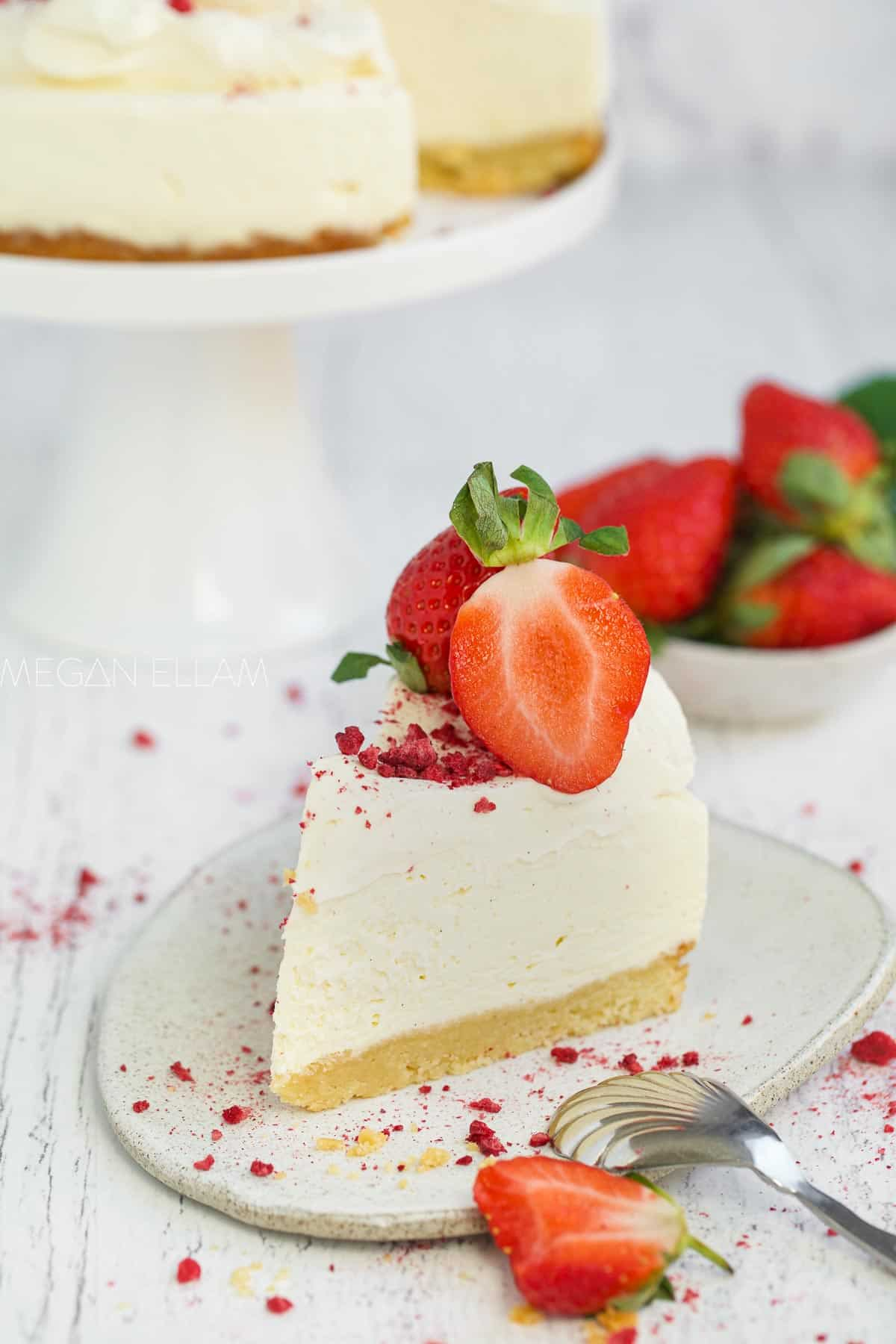 A slice of cheesecake on a plate with berries.