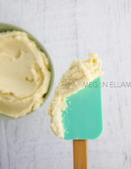 Keto frosting on a green spatula.