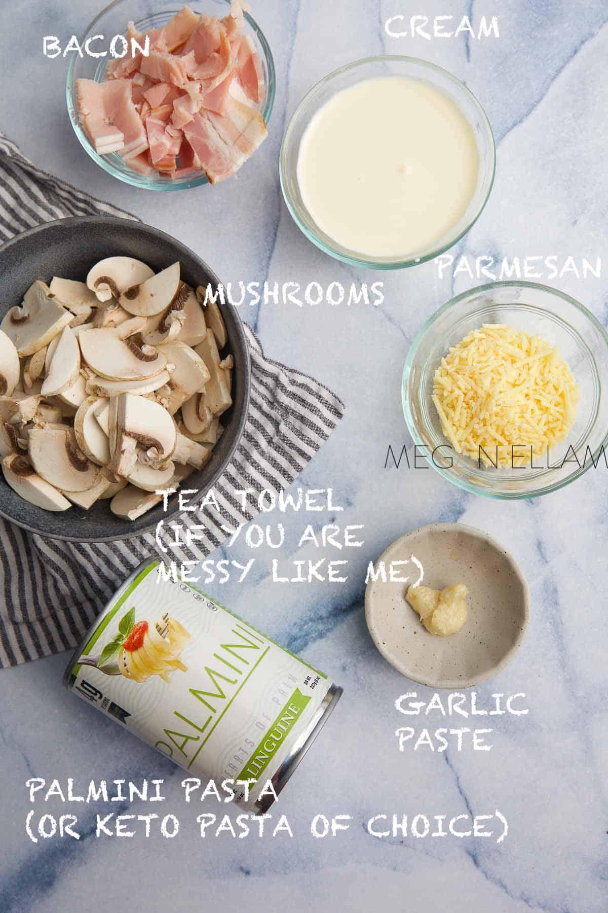 Keto Palmini pasta recipe ingredients in small bowls.