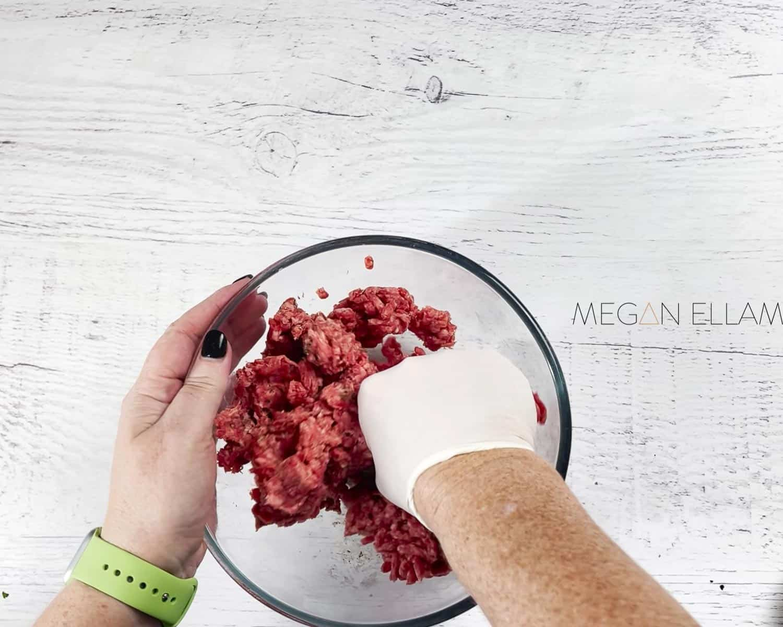 Hands making burgers.