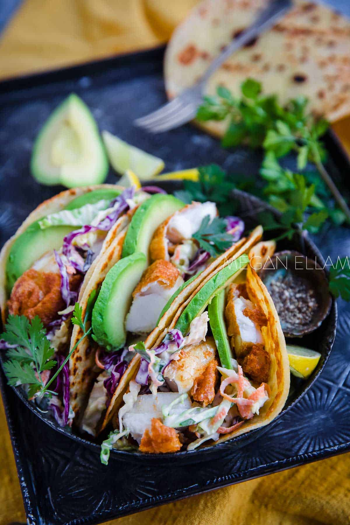 Fish Tacos on a grey plate.