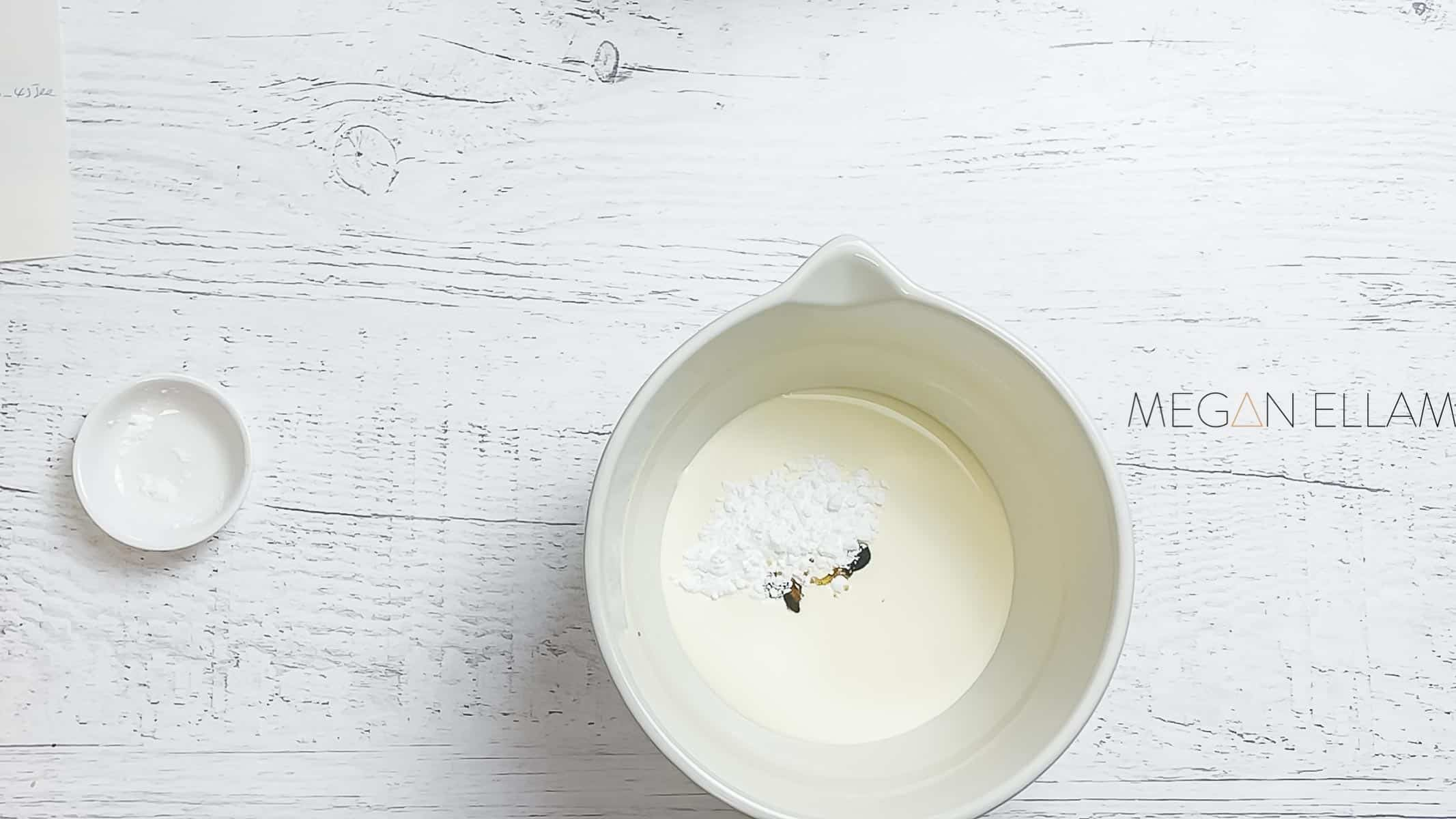 Cream, sweetener and vanilla extract in a bowl.