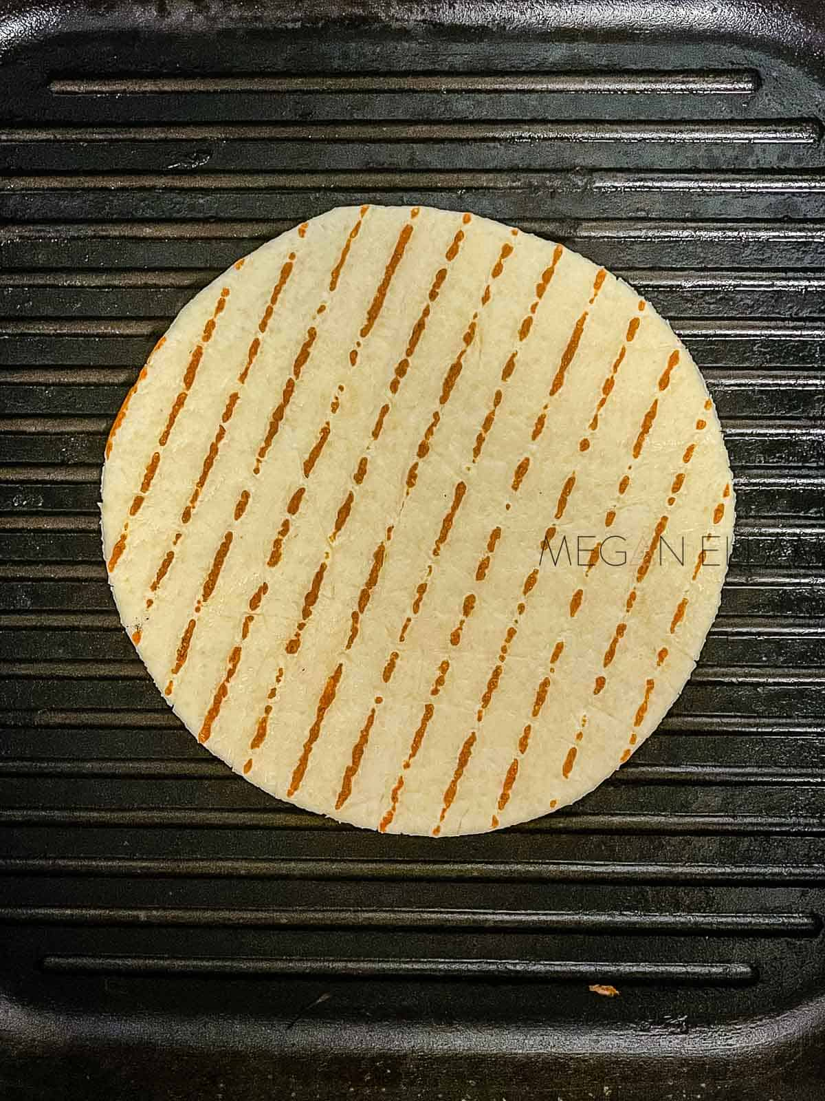 A wrap on a griddle plate.