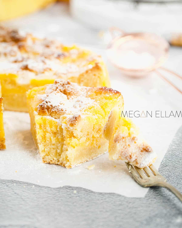 A fork full of lemon curd cake.